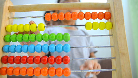 006-HD Close up shot asian little girl playing abacus Footage