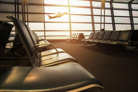 Airport Terminal with empty chair and bursting light, Airplane B Photo