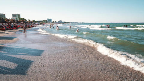 People Having Fun In Water And Relaxing In Mamaia Beach Resort Footage