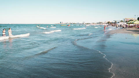 People Having Fun In Water And Relaxing In Mamaia Beach Resort Image