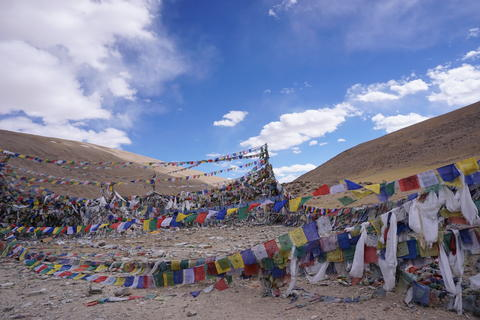 Buddhist prayer flags over the hill and beautiful blue sky in North India Fotografía