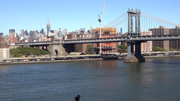 USA New York City Manhattan Bridge with East River seen from Brooklyn Bridge Footage