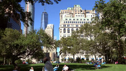 USA New York City Manhattan buildings seen through trees in Battery Park Image