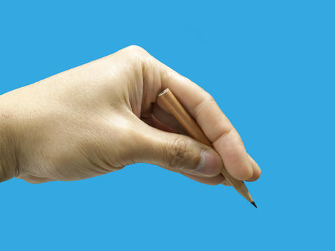 Male hand holding a pencil Photo