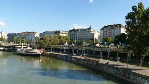People walking along the Donau river in Vienna, Austria Footage