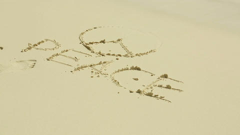 Peace sign on sand Footage