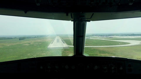 Airplane has a hard landing in summer day.Camera in cabin of pilot Footage