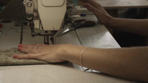 Worker makes seams on sheathing by sewing machine in furniture factory Footage