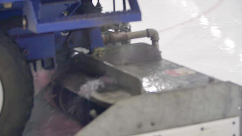 Big blue ice resurfacer truck polishes ice rink Footage