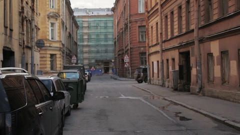 View of city street with signs and cars in summer evening. Camera moves forward Live Action