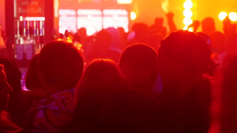 People stay in nightclub focus in, jumping people on background. Slow motion Footage