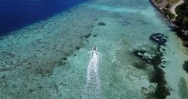 v06206 Aerial flying drone view of Maldives white sandy beach jetski riding sunn Footage
