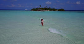 v06252 Aerial flying drone view of Maldives white sandy beach 1 person young bea Live Action