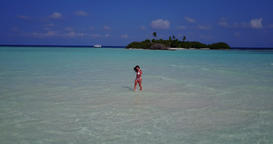 v06254 Aerial flying drone view of Maldives white sandy beach 1 person young bea Live Action