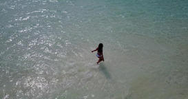 v06267 Aerial flying drone view of Maldives white sandy beach 1 person young bea Live Action