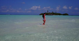 v06275 Aerial flying drone view of Maldives white sandy beach 1 person young bea Live Action