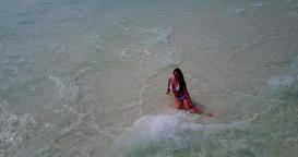 v06280 Aerial flying drone view of Maldives white sandy beach 1 person young bea Live Action