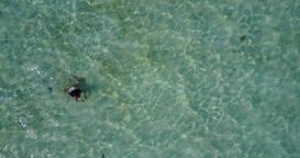 v06328 Aerial flying drone view of Maldives white sandy beach 1 person young bea Live Action