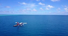 v06370 Aerial flying drone view of Maldives white sandy beach airplane seaplane Footage