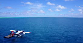 v06381 Aerial flying drone view of Maldives white sandy beach airplane seaplane Footage