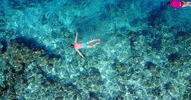 v06428 Aerial flying drone view of Maldives white sandy beach young people snork Footage