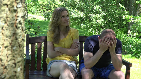 split spouse couple sit sad on bench and hug with relief. 4K Live Action