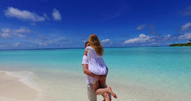 v07475 Maldives white sandy beach 2 people a young couple man woman standing tog Footage