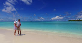 v07477 Maldives white sandy beach 2 people a young couple man woman standing tog Footage