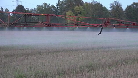 Sprayer equipment spray herbicides chemicals on field. Follow. 4K Live Action