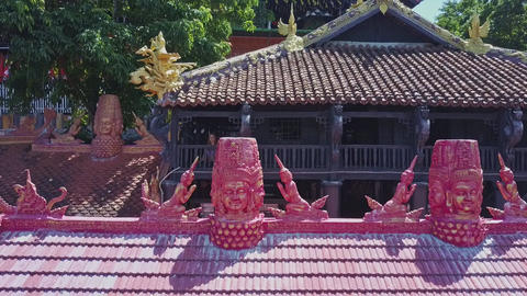 Drone Moves from Carved Holy Pink Figures to Golden Dragon Footage