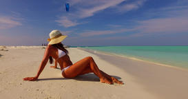 v07840 Maldives white sandy beach 1 person young beautiful lady sunbathing alone Live Action