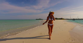 v07845 Maldives white sandy beach 1 person young beautiful lady sunbathing alone Live Action