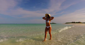 v07847 Maldives white sandy beach 1 person young beautiful lady sunbathing alone Live Action