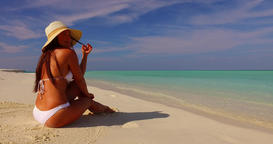 v07854 Maldives white sandy beach 1 person young beautiful lady sunbathing alone Live Action