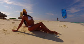 v07856 Maldives white sandy beach 1 person young beautiful lady sunbathing alone Live Action