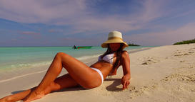 v07859 Maldives white sandy beach 1 person young beautiful lady sunbathing alone Live Action