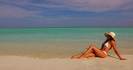 v07863 Maldives white sandy beach 1 person young beautiful lady sunbathing alone Live Action