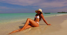v07866 Maldives white sandy beach 1 person young beautiful lady sunbathing alone Footage