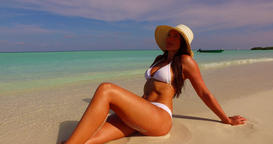v07867 Maldives white sandy beach 1 person young beautiful lady sunbathing alone Live Action