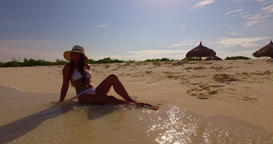 v07869 Maldives white sandy beach 1 person young beautiful lady sunbathing alone Live Action