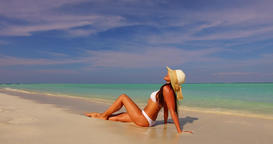 v07871 Maldives white sandy beach 1 person young beautiful lady sunbathing alone Live Action