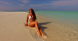 v07884 Maldives white sandy beach 1 person young beautiful lady sunbathing alone Live Action