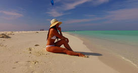 v07894 Maldives white sandy beach 1 person young beautiful lady sunbathing alone Live Action