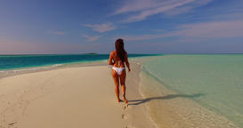 v07898 Maldives white sandy beach 1 person young beautiful lady sunbathing alone Footage