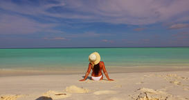 v07905 Maldives white sandy beach 1 person young beautiful lady sunbathing alone Live Action