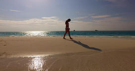 v07911 Maldives white sandy beach 1 person young beautiful lady sunbathing alone Live Action
