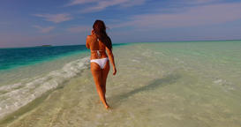 v07913 Maldives white sandy beach 1 person young beautiful lady sunbathing alone Live Action