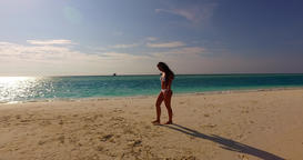 v07920 Maldives white sandy beach 1 person young beautiful lady sunbathing alone Live Action