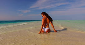 v07931 Maldives white sandy beach 1 person young beautiful lady sunbathing alone Live Action