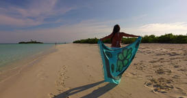 v07936 Maldives white sandy beach 1 person young beautiful lady sunbathing alone Live Action